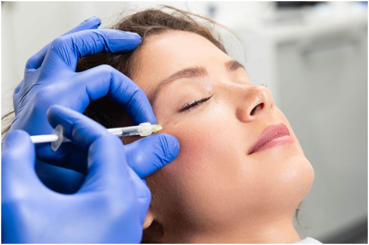 young woman is getting a rejuvenating facial injections